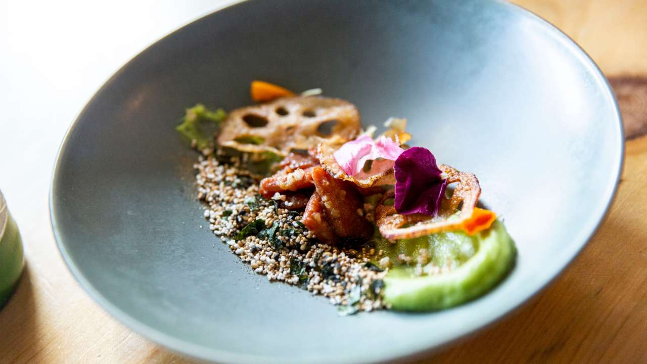This salmon dish from the tasting menu at Olympia Oyster Bar in Portland, Oregon is made from cultivated salmon and not farmed salmon – the meat is grown from salmon cells. Image: Rachelle Hacmac/Wild Type