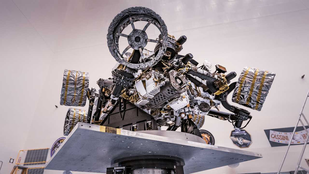 NASA's Perseverance rover can be seen attached to a spin table during a test of its mass properties at the Kennedy Space Center in Florida. During the test, the rover was rotated clockwise and counterclockwise to determine its center of gravity. Image credit: NASA/JPL-Caltech