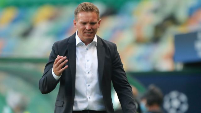 Leipzig's head coach Julian Nagelsmann gestures during the Champions League quarterfinal match between RB Leipzig and Atletico Madrid at the Jose Alvalade stadium in Lisbon, Portugal, Thursday, Aug. 13, 2020. (Miguel A. Lopes/Pool Photo via AP)