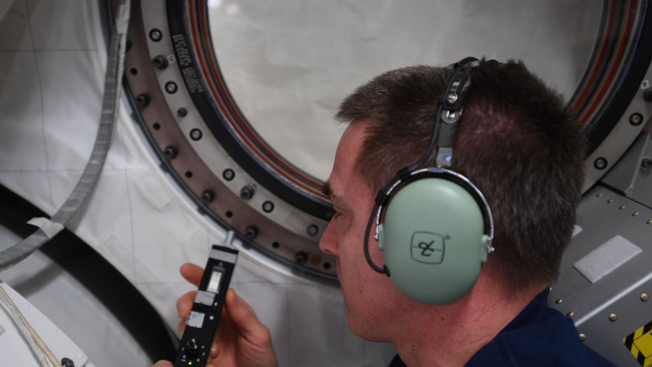 NASA astronaut Chris Cassidy running checks on one of the space station's modules. Image Credit: Twitter/@Astro_SEAL