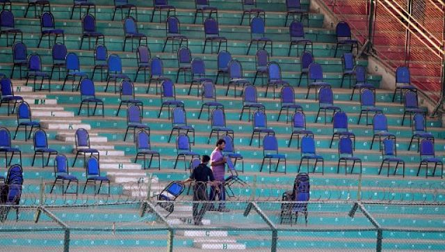 Ground staff members arrange chairs in the stands at the National Cricket Stadium in Karachi ahead of the first match of the Pakistan Super League. AFP