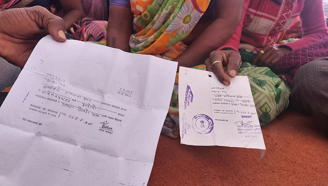 Farmers brought court documents proving their occupancy of their land to the Azad Maidan protest in Mumbai. Firstpost/Natasha Trivedi